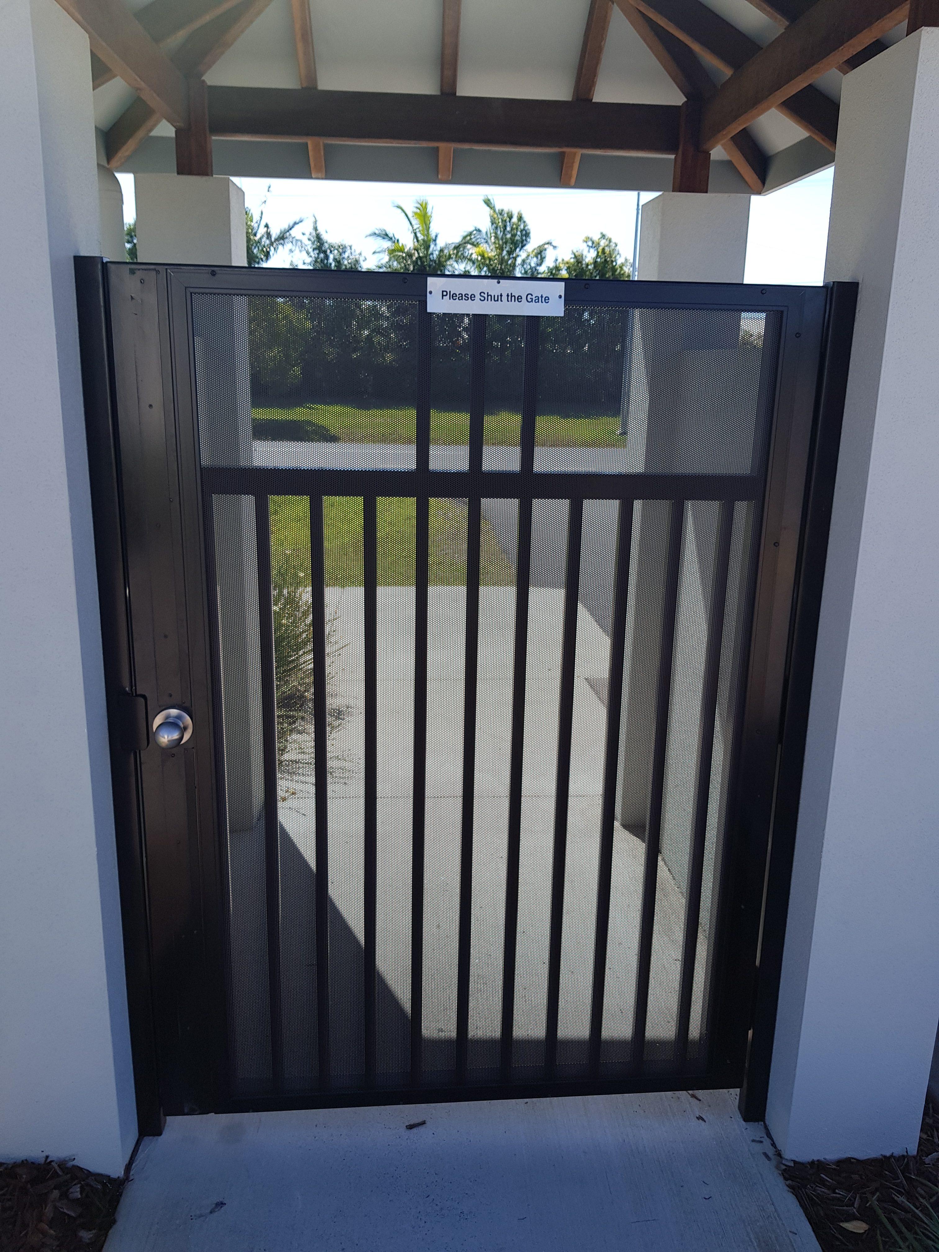 Xceed Perforated Aluminium Screen over Gate